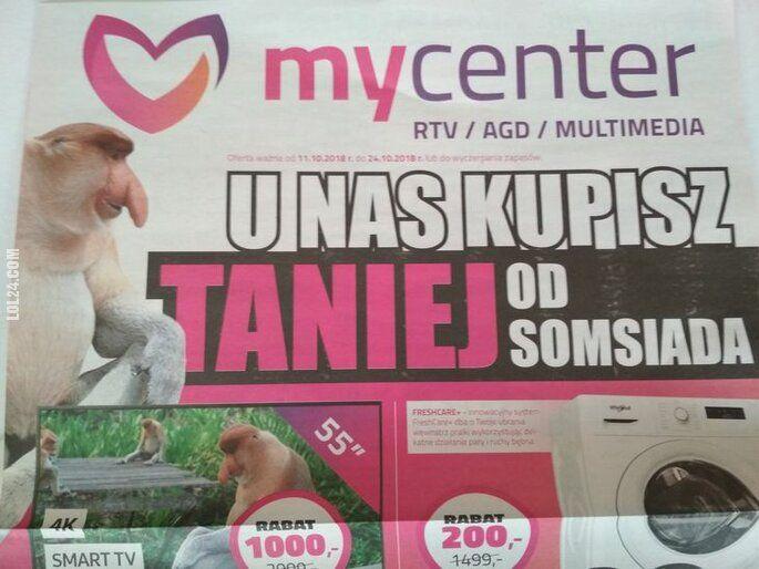 """napis, reklama : """"U nas kupisz taniej od somsiada"""" Gazetka mycenter"""