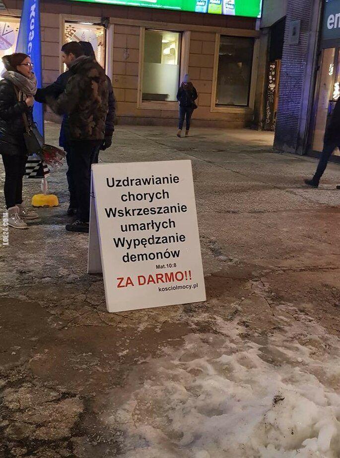 napis, reklama : Tymczasem w XXI wieku w Warszawie