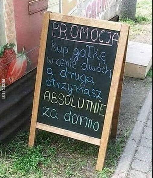 """napis, reklama : """"Miszcz"""" marketingu"""