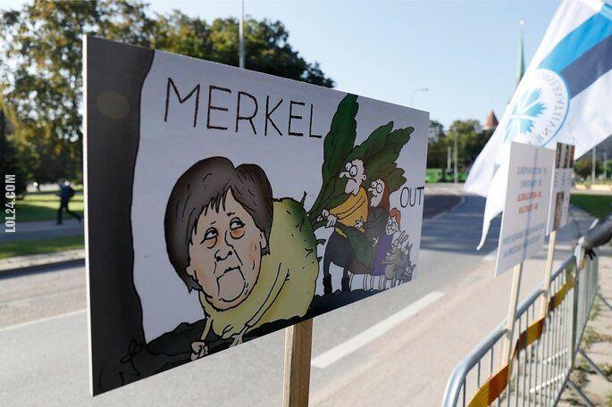 "napis, reklama : Estonia: ""MERKEL OUT"""