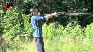 Holding a shotgun like a handgun